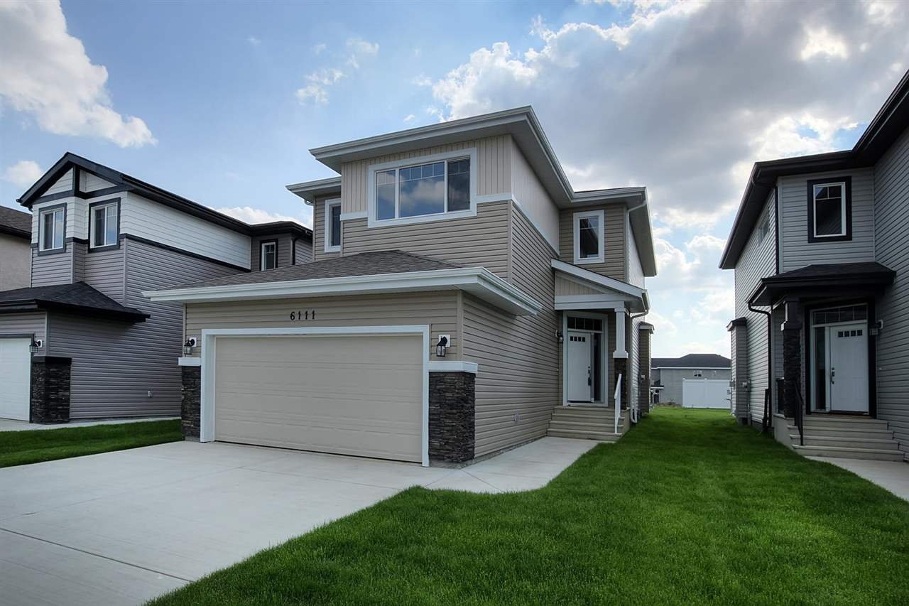 Stunning BRAND NEW HOME ready for immediate possession. Fantastic location easy access to Henday minutes from ever growing 167 Ave & Manning Retail with Cineplex, shopping, restaurants and more. This home has it all! Over 1900 Sq Ft 4 bedroom, 2 1/2 bath home includes 6 appliances including ICEMAKER. Fantastic functional floor plan. Step into generous CERAMIC TILE foyer with VAULTED ceiling featuring a wonderful WALK THRU CLOSET to the garage entrance and your fabulous MAIN FLOOR LAUNDRY room with sink. A huge WALK-THRU PANTRY takes you into your modern kitchen with GRANITE COUNTERS and large dining area opens out onto the south facing backyard for those summer BBQ's. Spacious GREAT ROOM style living room is highlighted by a heartwarming FIREPLACE feature wall with tile surround. Beautiful METAL AND WOOD RAILINGS take you upstairs to; HUGE MASTER SUITE with 5 pce SOAKER TUB enusite, BONUS ROOM, 2 more large bedrooms and den/bedroom and 4 pce main bath. EXTRA LONG GARAGE! 10 YEAR Progressive Home Warranty!