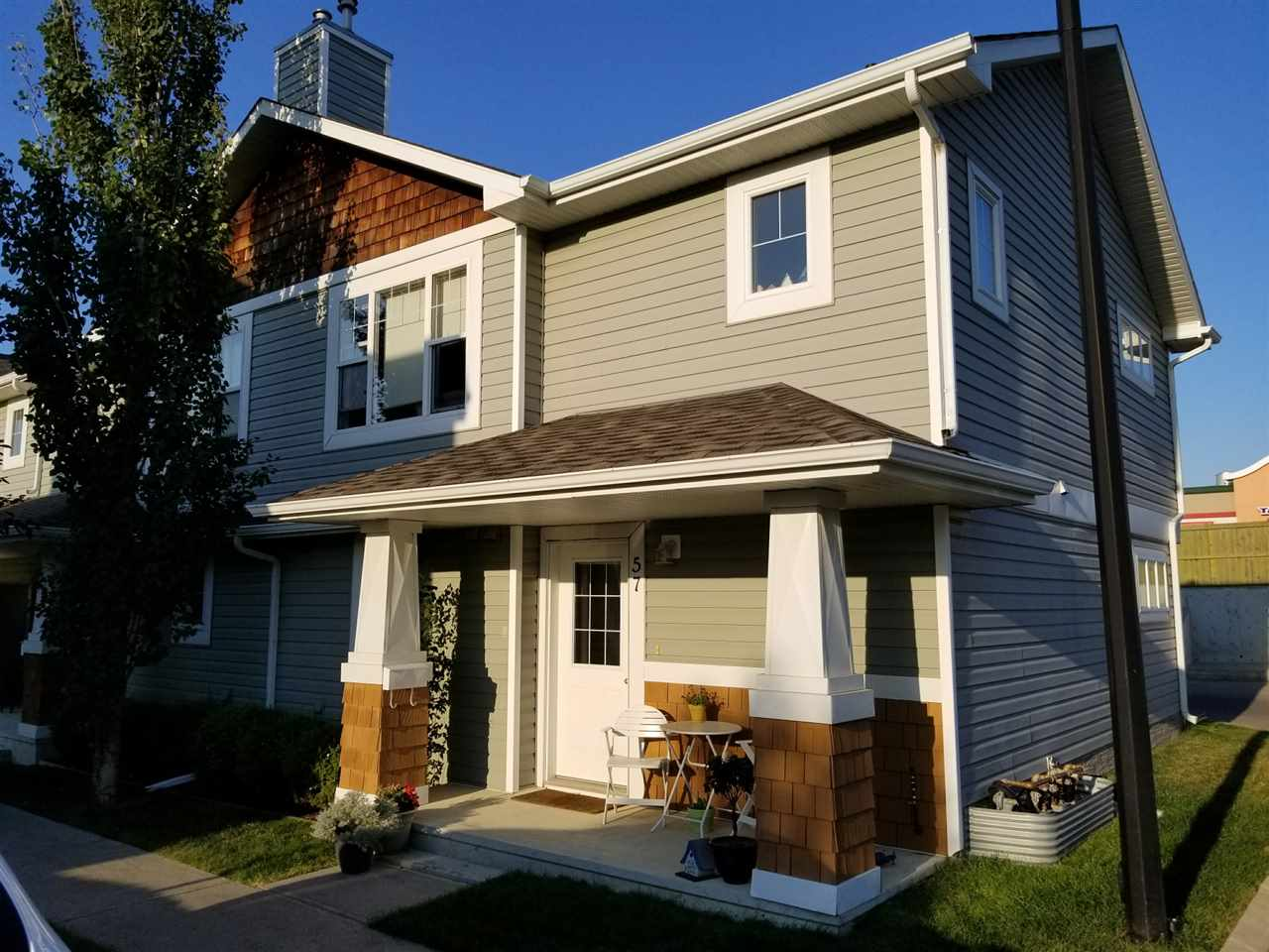 Located in the heart of Sherwood Park, this end unit is move in ready. This 2 Storey townhouse style condo features a single garage and walking distance to all amenities. The main floor has a bedroom, 4 piece bath, access to garage and the laundry/storage room. The upper level features a great room floorplan with a living room, kitchen with black appliances, Master bedroom and another 4 piece bath. Out front is your West facing concrete patio with natural gas BBQ hookup and room for a patio table and chairs. Low condo fees, an Adult only complex in a well maintained community.