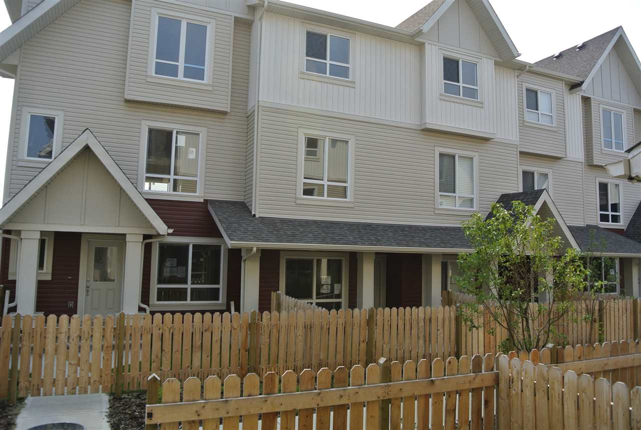 Step into this beautiful new townhome with all the perks you and your family needs. Park your two cars comfortably inside the tandem garage. Then wonder up to your large open concept kitchen and breakfast nook overlooking your large balcony. Let your eyes lead you back into the dining and living area where its boasting with natural light from large windows. Cozy up next to the fireplace mounted on 3-sided stone wall. Upstairs you will find your Master bedroom, 3 piece ensuite and his and her closets. Two good sized rooms are on the south side of the home and the main bath, linen closet and laundry closet complete this fine townhome. Enjoy Vinyl Flooring Throughout this home!  Check out our other showhomes on site with even more options!