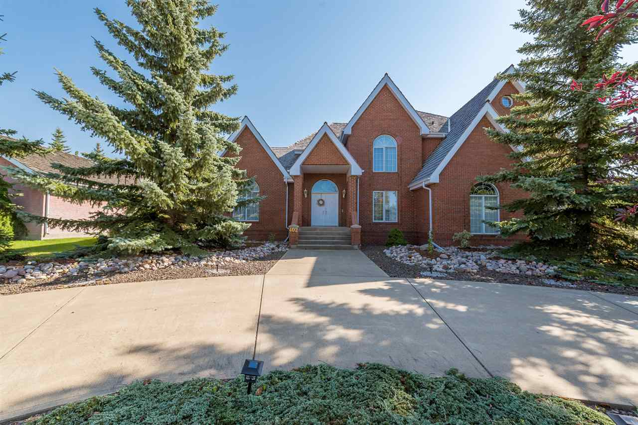 Stunning family home located in the prestigious ?Estates of Sherwood Park?. Over 4600 sq.ft. of quality workmanship! Upon entering the home, you are welcomed by grand foyer and gleaming hardwood floors. Next, you will find large and elegant living room, a spacious dining room perfect for big family gatherings and a bright, gourmet kitchen. Sunny dinette adjacent to the kitchen and leads to private south facing deck and yard with many trees. Main floor also offers family room with cozy fireplace, office, 2pc bathroom and laundry room. Upstairs includes large master bedroom with ensuite creating a spa-like retreat, as well as 3 other big bedrooms, 1 with an ensuite and 4pc bathroom. Fully finished basement offers huge recreation room/gym area, full bathroom and plenty of storage space. Basement hallway leads you to an indoor pool (in separate building). You will enjoy swimming in this heated 40? x 14? pool! Triple-car attached garage. Close to shopping and transportation yet very quiet and private location.