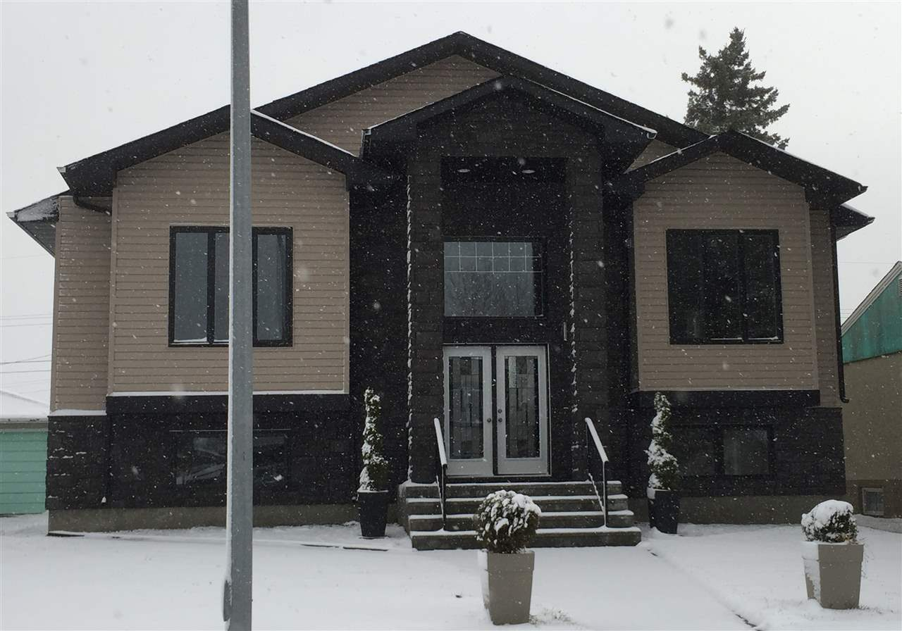 Custom design 1890 sqft bi-level style, built in 2015, bright, open concept with 10 foot ceilings, total 6 bedrooms & 3 full baths Your stunning kitchen features white high gloss cupboards, pot drawers, large pantry & granite counter top with bar style island. The main floor is finished with hardwood floors, ceramic tiles, gas fire place in the living room, plus the master bedroom boasts two-way fireplace overlooking the ensuite bath with a corner jacuzzi tub, shower features, steam, radio, telephone line, massage jets plus an unique bidet with heated seat. Basement is fully developed with laundry & storage all in laminate flooring plus ceramic tiles in the 4-pc bath. For your toys we have a 4 car garage that?s insulated, heated with 10 foot garage door, 35x22, dry walled & painted with 220 voltage plug Perfect home for a multi generation family or 2 familes blending into one. Your new home is close to shopping, schools and public transportation.