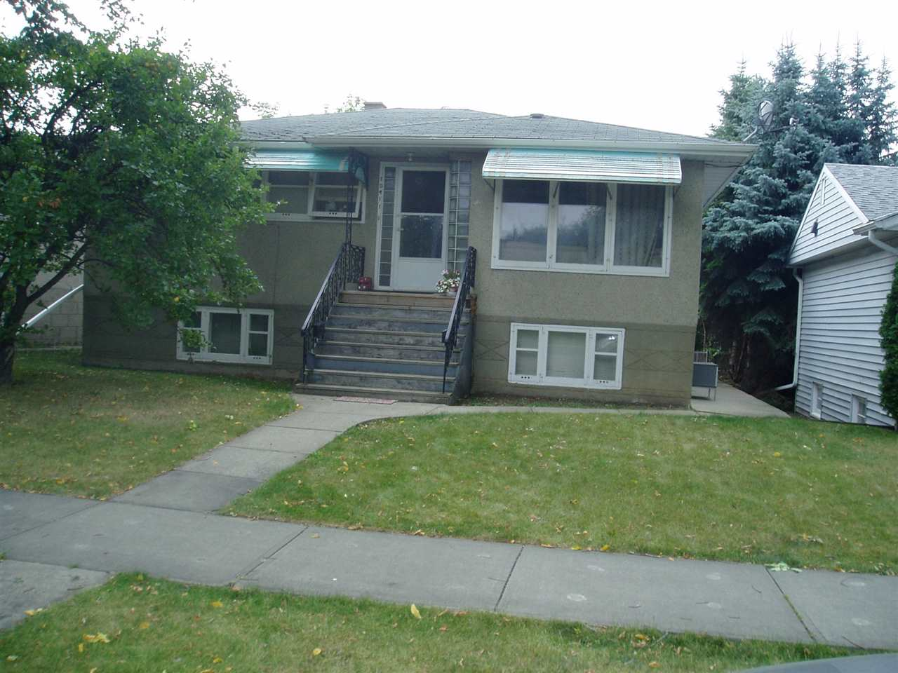 Raised bungalow with separate entrance from outside as well as inside to the lower level which has 2 bedrooms, bathroom as well as living room and kitchen. Three bedrooms up. The property is in a great very popular location close to parks and trails. Long term tenants. The property is complimented with a 22ft. x 24ft. double garage as well as concrete sidewalks.  The property requires upgrading.