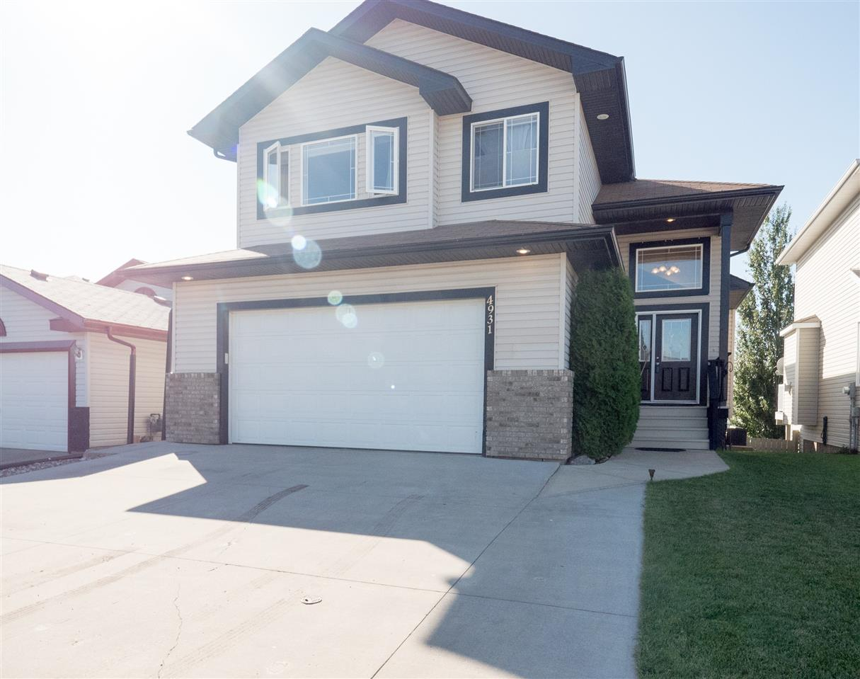 Beautiful custom built walk out in quiet cul de sac.  1769 sq ft 1 1/2 storey home with 4 bedrooms and 3 1/2 bathrooms.   Stunning high ceilings, large windows and open concept.  Large kitchen opens to the living room with hardwood and built in cabinetry.  Also on the main floor is a 2 pc bath and a spacious dining area that opens to the large south facing deck.  Upstairs you have a roomy master with large walk in closet and 4 pc ensuite with soaker tub.  Two more bedrooms and a 4 pc bath finish up the top level.  And the walk out basement is completely finished as well with high ceilings and lots of light.  Newly renovated 4 pc bath, large bedroom, rec room and laundry complete this level.  The garage is oversized 22'x20' and the cement driveway is large enough to park 3 vehicles!  This home is located conveniently close to Manning Crossing, Manning Freeway and Anthony Henday!