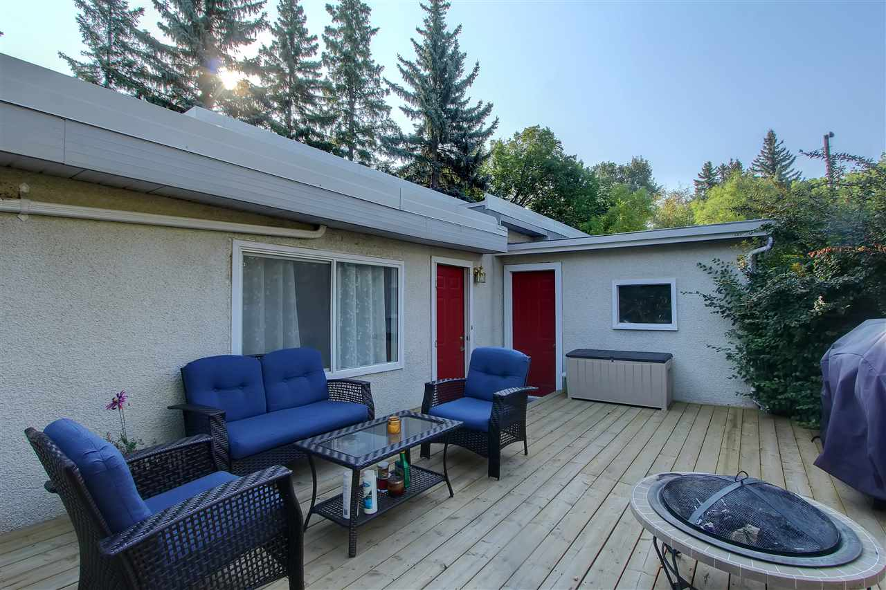 The newly replaced side deck is right off the main floor family room. It is spacious and private.