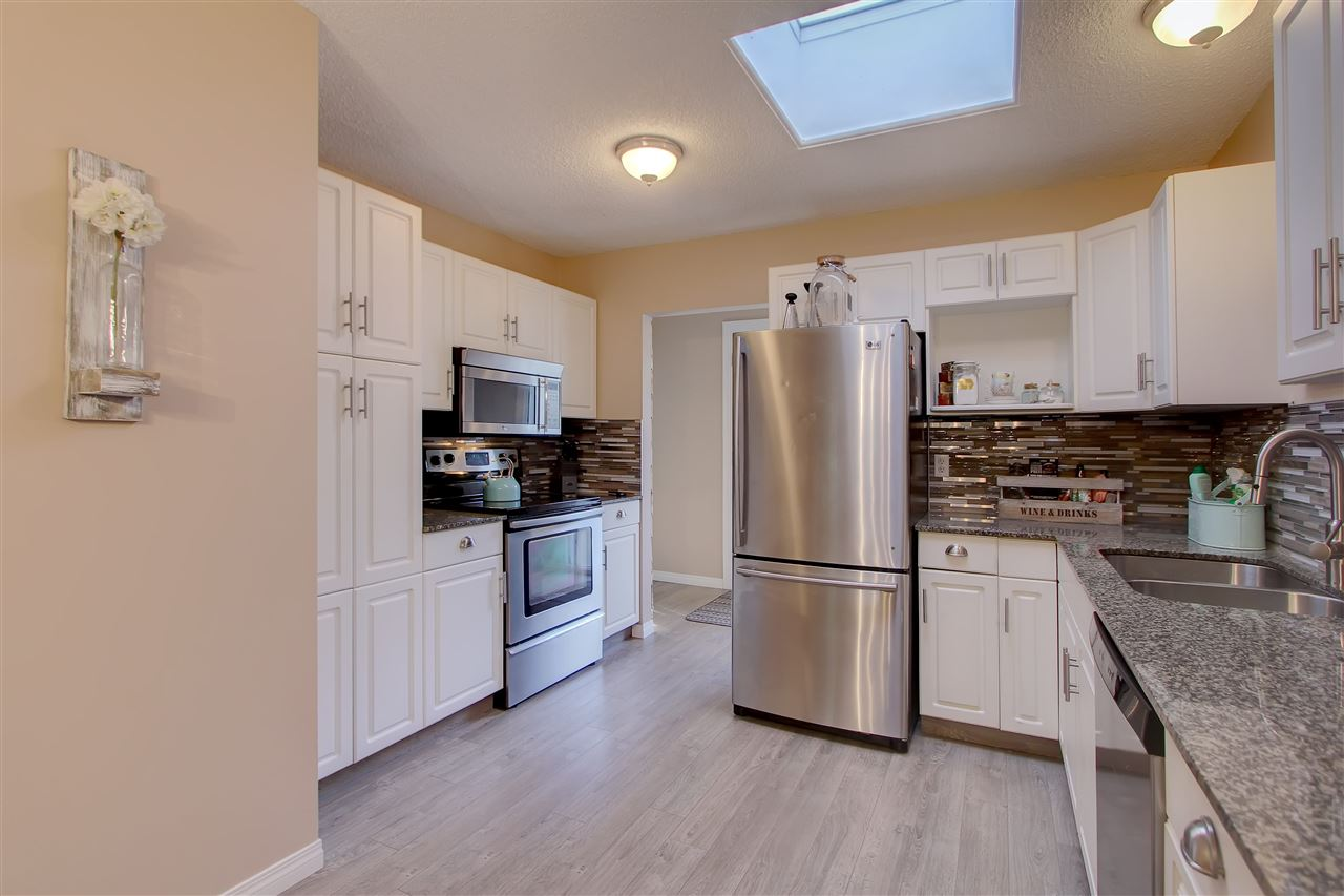 The kitchen has another wall of cupboards facing into the L shaped area. There is a pantry and more space for you to store items and the oven is here as well.. making a nice work triangle for efficiency.