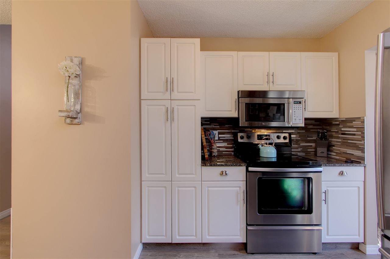 This shows the pantry on the wall facing the larger L shaped portion of the kitchen.
