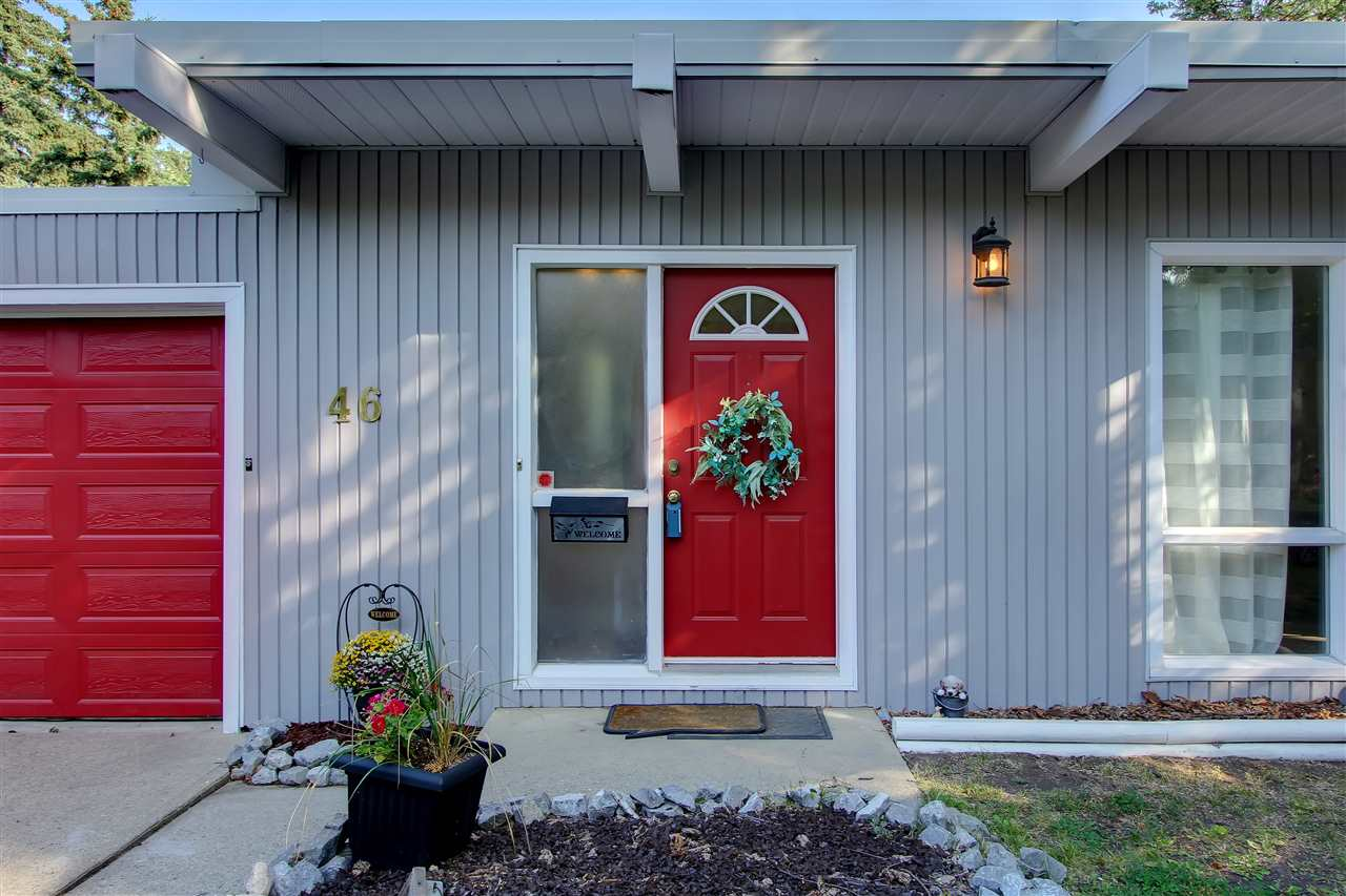 RED is such a happy colour... This home welcomes you every time you arrive. You will be proud to welcome friends and family to this home that backs onto a RAVINE...