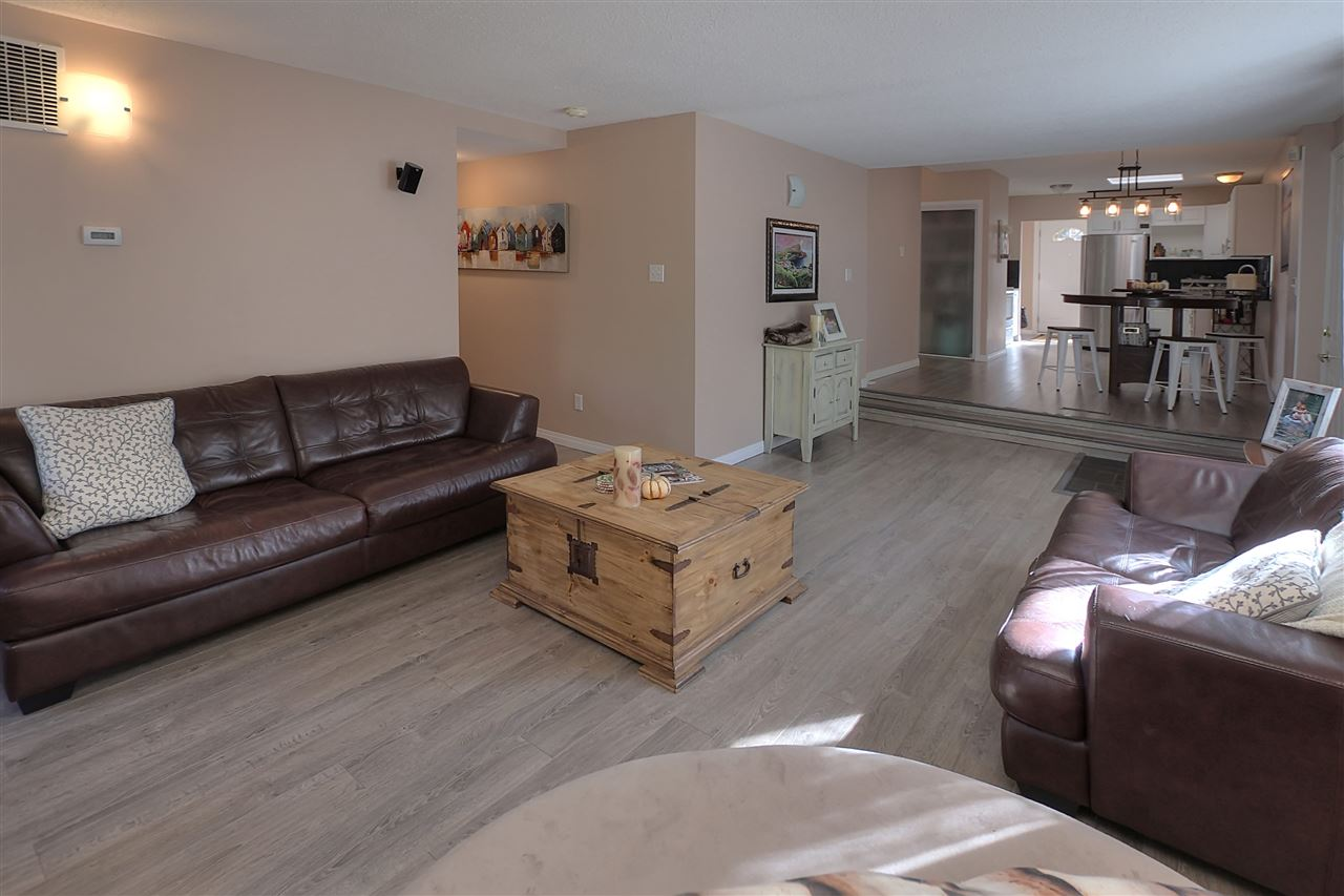 From the family room you are open to the casual eating area and beyond the updated kitchen.