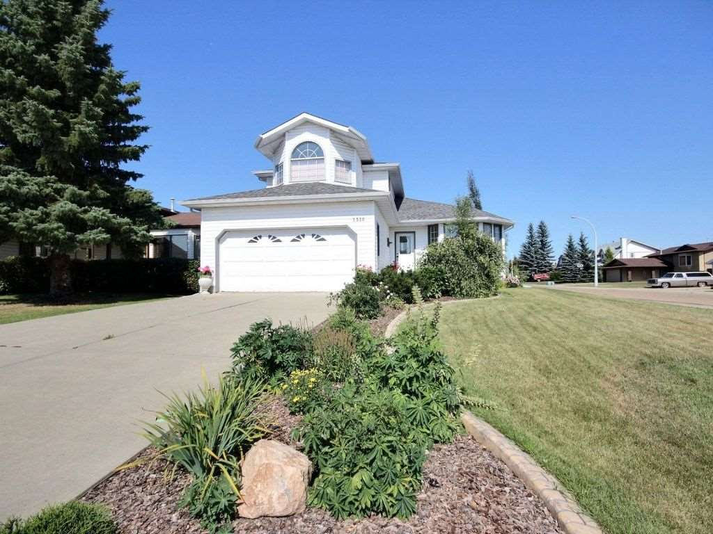 Beautiful, open  floor plan home on corner lot on quiet cul de sac in Stony Plain. Close to 2 schools and a walking path.Finished double attached garage. Huge windows throughout with sunroom having south and east exposure. Main floor laundry,wood burning fireplace, double swirl pool  bath in ensuite. 3 bedrooms up with a possible bedroom or office on main floor. Central vac. Newer siding and newer 35 year shingles. No smoking and no pets home. Two decks in huge backyard. Mature trees, landscaped with paving stone path. Large patio. Underground watering system for lawns and all flower beds.