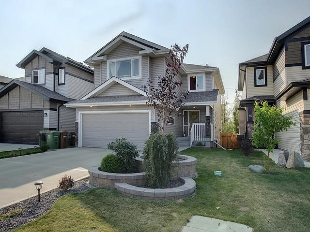 Welcome to this spacious 2 storey home backing the trees in the popular neighbourhood of Northridge. The large entrance has tile flooring, built in maple bench & access to the double attached garage. The OPEN DESIGN and large back windows give great views of the trees out back. The kitchen has full height dark cabinetry, pot lighting, corner pantry, eating bar peninsula, pot/pan drawers, under mounted sink, tile back splash, s/s appliances & GRANITE counter tops. The dining nook has a garden door to the spacious back deck. The great room has HARDWOOD FLOORING & a GAS F/P. The main floor is complete with a 2pce bath. The 2nd floor has a large, open bonus room w/ VAULTED ceilings, 3 bedrooms a 4pce main bathroom & a 4pce en suite. The master bedroom features a walk in closet & views over the back yard. The en suite has HEATED FLOORS & a separate shower from the soaker tub. The FULLY FINISHED basement has a rec room, 4th bedroom, 3pce bath, storage room & a mech/laundry room. Move in Ready with CENTRAL A/C!