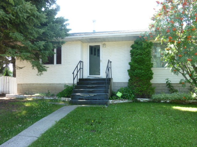 5 bedroom walkout bungalow with double detached garage.  Needs some TLC