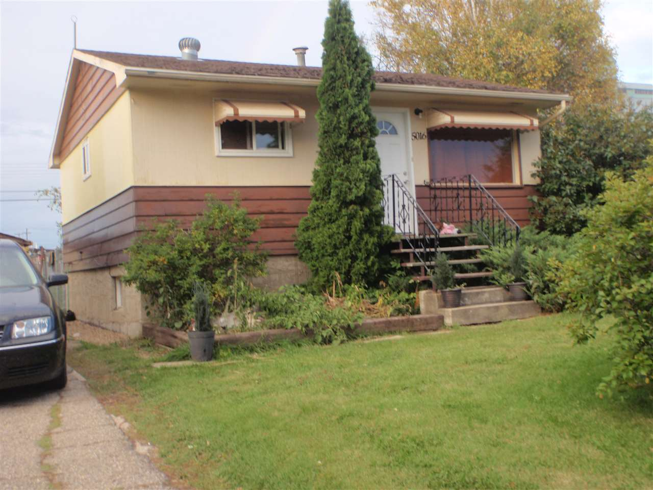 This starter home is ready and waiting for you. Two bedroom 704 sq. ft. bungalow with large yard, a smaller 12' x 22' detached garage and a garden spot. Upgrades include most windows, interior doors / closet doors, laminate flooring on main, renovated main bath, furnace & hot water tank in 2011, chain link fencing & a fire pit. Basement also has some recent renovations with open style rumpus room (a wall could easily be installed to make a 3rd bedroom).