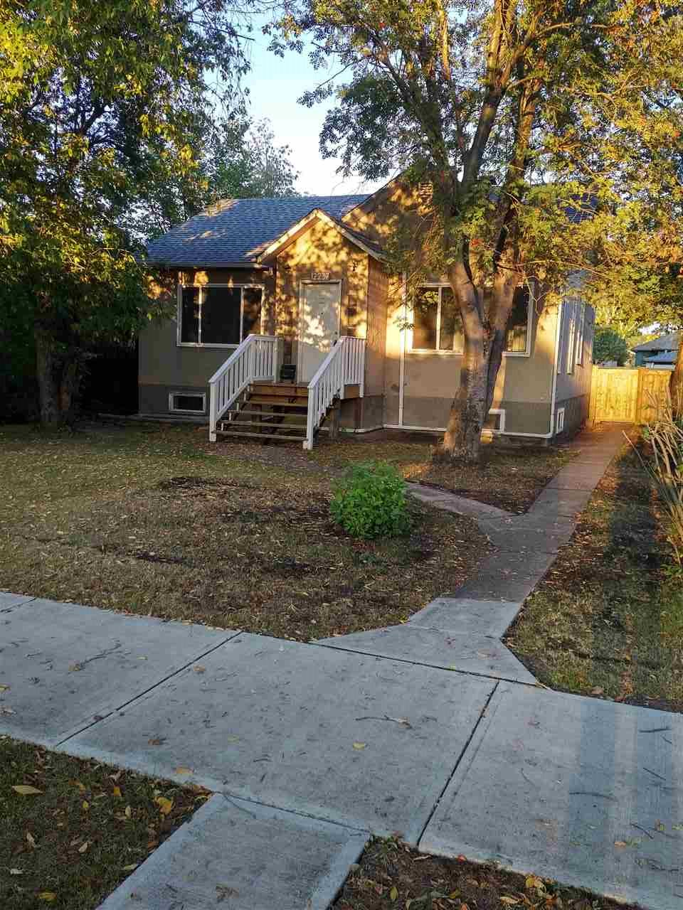 Great opportunity for a family, Investor or Builder. Solid 3 bedroom bungalow  sitting on a large 50' by 150' (RF3) Duplex lot just north of NAIT. This home received a number of upgrades in 2005; new furnace, HWT, electrical panel plus a number of windows. The owners also installed  sump pump at that time. New shingles were put on the home 4 years ago. Just recently new steps, back deck, fence and garage shingles were all done. New laminate in the LR and paint throughout. The main floor has a large living room, dining room, kitchen, 2 bedrooms plus full bath. The basement has a large family room, bedroom, 2nd kitchen plus 3 piece bath. Laundry and utility room complete the basement. The large yard can be enjoyed by your family or a duplex could be built in the future! Lots of parking, great location and future potential.