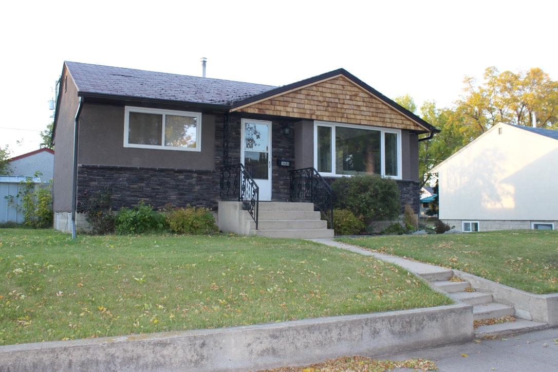 Beautifully remodelled home in the heart of Fort Saskatchewan.Close to the river valley, restaurants and shopping. Great curb appeal with stone work, cedar shakes, new windows throughout and painted stucco. Inside you will find a bright living/dining room with the original oak hardwood floors. Both bedrooms have new carpet and large sunny windows. Bathroom has been completely updated with a new tub, tile surround and vanity. The fresh fabulous kitchen features plenty of new white cabinets, subway tile backsplash, laminate counter tops and SS appliances. Downstairs is a cozy recreational area, with new carpet and drywall. There is a good sized bedroom and 3 piece bathroom. New furnace too! Pretty back yard with concrete patio and single car garage.
