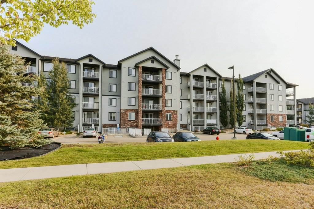 Welcome home to this spacious condo! Perfectly situated within the bldg on the second floor end unit. Taking full advantage of the mature trees around the private balcony that faces south, west & north, it is large enough to host BBQ's or just simply to cozy up with your morning coffee. The kitchen, with rich expresso colored cabinetry & st/st appl's, offers tonnes of counter space including a massive eat up counter. Off the kitchen you could have any size kitchen table, the sky's the limit and still it would not impede on the large living room filled with natural light. Both bedrooms could be used as masters due to the size, however one has a walk-thru closet into the 4 pc ensuite.  This is a smart floorplan which also includes in-suite laundry plus a generous sized storage room. Comes with a/c and has 2 energized parking stalls! Beautifully maintained, this is a smart buy.