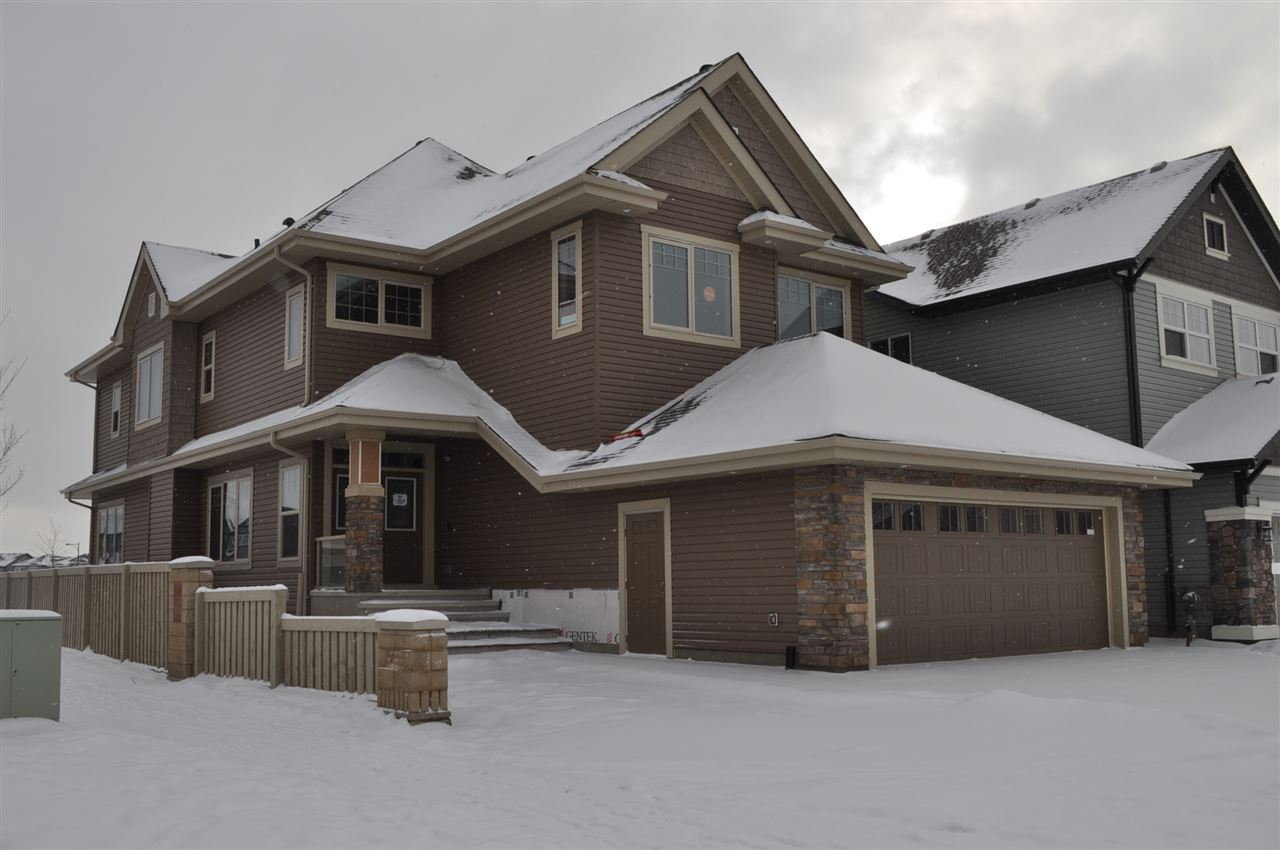 The seller's put their heart and soul into this custom built 3200sqft. 2 storey with a basement suite a in the most desirable community of Allard. The up-grades have the wow factor. The main floor consist of contemporary design with matt wide blank hardwood and marble flooring. Double door entrance with a spacious foyer, great room with feature fire place, breakfast nook, professional dining rm, den, and a stunning kitchen with a granite water fall island, antique white cabinetry and a walk - in pantry surrounded with high end S/S appliances. The 2nd Level offers a vaulted ceiling media room with build in media screen , Master Bdrm w/5-Pc En-Suite & 2 walk in closets, 2 more bedrms with adjoining ensuite with a steam shower, guest bathroom and laundry. The 1 bedroom basement suite is high quality as well with laundry rm. The basement also has a spice kitchen and 2nd media room with a 4 pce bathroom. There are 6 bathrms and 4 bedrooms in this house! Located on a corner lot that backs onto a park.