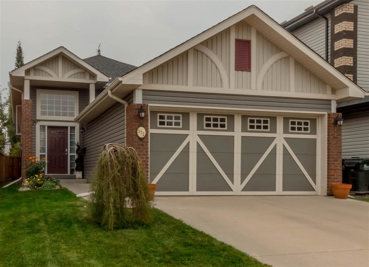 """""""Aspen Trails Beauty""""! Every Square foot of this exceptional Turn-key Bi-Level has been optimized for use! Large main floor Kitchen with ginger maple cabinets, vaulted ceilings, generous master with ensuite, The 2 other bedrooms share a 4 pc bathroom, loads of natural light! Imagine the options as the front entrance leads downstairs to a fully finished basement with a full second kitchen! Spacious family room with natural gas fireplace, large bedroom hidden behind french doors with full ensuite.  Nicely landscaped, treed yard, with elevated deck, and double garage. Loads of character and exceptional value! Don't miss out! Well worth a look.."""