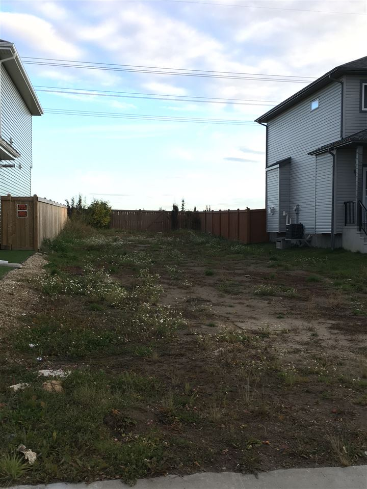 Vacant lot backing green belt, build whatever you want!