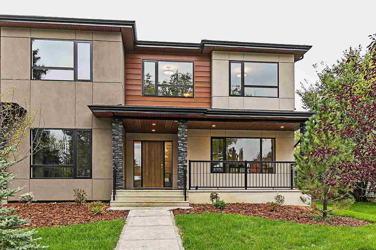 Luxurious and modern brand new half duplex in the sought after neighborhood of Parkview. Upon entering you will be delightfully greeted with hardwood flooring flowing through the open concept main floor. Living room is highlighted with a wine bar and stunning 2 sided tiled gas fireplace which is shared with dining area. The chef inspired kitchen offers quartz with waterfall island, soft close cabinets and sleek stainless steel appliances. Rounding off the main floor is a mudroom with built in benches and 2 piece powder room.  Upstairs is the master oasis with a modern styled barn door leading to the spa like 5 piece ensuite and a massive walk in closet.  2 additional bedrooms with walk in closets, another full bathroom and conveniently located laundry room. Basement is fully finished with a spacious family room, 4th bedroom and 4 piece bath. This home comes complete with a deck with BBQ has hook up, privacy screen and glass railings and double detached garage. Just minutes away from the River Valley!