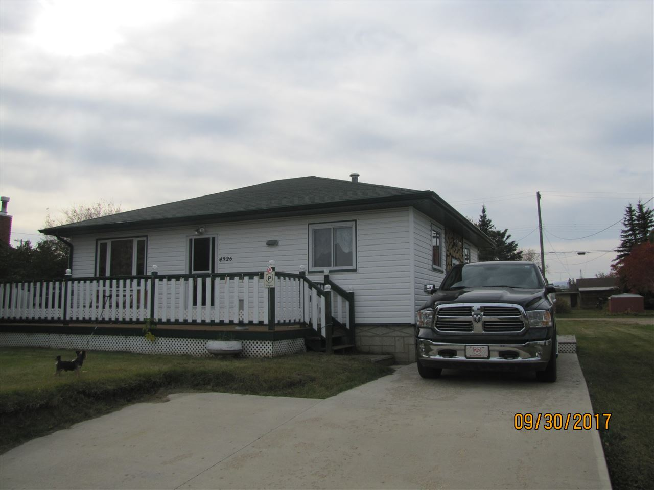 Beauiful 2+1 bedroom bungalow located on a quiet street in the town of Smoky Lake. This fully upgraded home has new kitchen cabinets, counter tops, flooring, paint, bathroom, & finishing throughout the home. The basement has 1 bedroom, and is partially finished with a 2nd bathroom. The mechanical furnace and hot water tank are newer. The exterior of the home is low maintenance vinyl siding The home is on a full sized lot, & is fully landscaped.  All of the appliances are included in the sale of this home. This home shows a 10 out of 10