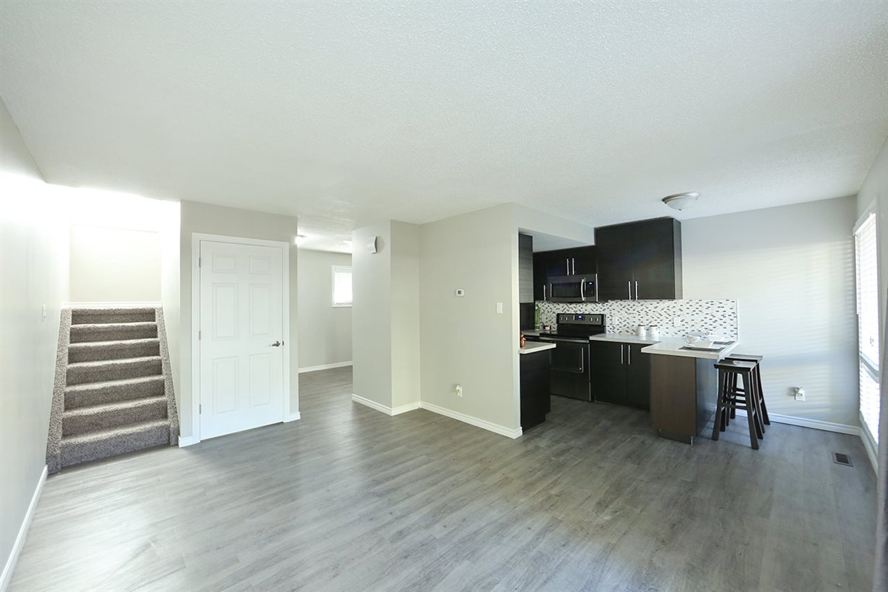 WOW- Take a look at this extensively renovated Townhome in Abbottsfield. From top to bottom, this place has it all. New Kitchen cabinets, countertops, stainless steel appliances, flooring, bathroom, windows and doors...this place as it all! As you walk into this modern masterpiece you'll instantly feel at home. Main floor has a large living room and dining room.  Upper floor has 3 generous sized bedrooms and a brand new 4 piece bathroom. Basement has been carpeted and painted making it the perfect spot for entertaining. Beautiful fenced yard and close to so many amenities makes this the perfect property. Act fast cause it won't last!