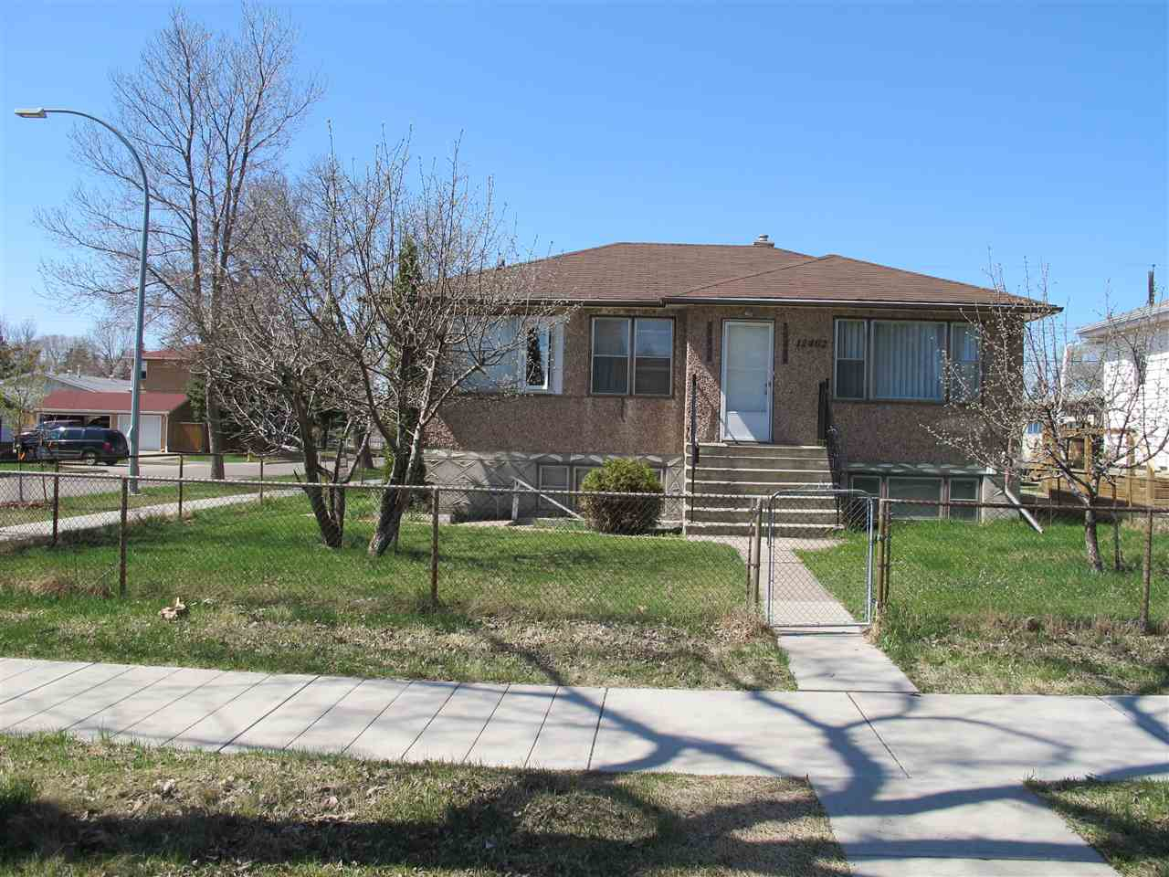 Investor Opportunity.  Raised bungalow with separate entrance to the basement.  3 bedrooms up plus 1 bedroom/den in the basement.  Double 25'x25' detached garage.  Basement with a second stove and fridge.  Great potential. large 50'x125' lot.  Infill project potential.