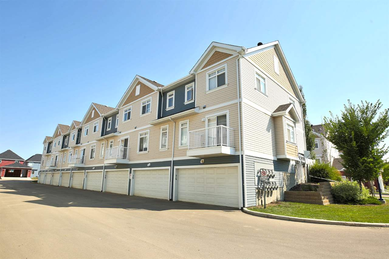 Enjoy lake access this summer at LAKE SUMMERSIDE! Move right in to this fully-upgraded 3 bdrm 2.5 bath townhome in Mosaic Summerside. Open-concept living features hardwood & tile floors, dark cabinetry, stainless steel appliances & breakfast bar on the main floor - home to the living rm, dining rm, kitchen, BALCONY & 2 pc bath. Upstairs, 3 large bdrms & 2 full baths (master bdrm has walk-in closet & ensuite!). Downstairs, you'll find the laundry, tons of storage & double-attached garage. Unit is located on the exit street (best/most private location in complex!) offering easy entry & exit from home. The front yard is fenced & very private (...it doesn't face other yards). There is a park to the east of the complex & a brand new catholic school (Father Michael Mireau Elementary/Junior High School) opening in September! A quick drive to 50 St & Ellerslie for Walmart, Sobeys, and other shopping. Close to public transit and all amenities. Enjoy summers at Lake Summerside! Total living space w/ bsmt =1304sqft