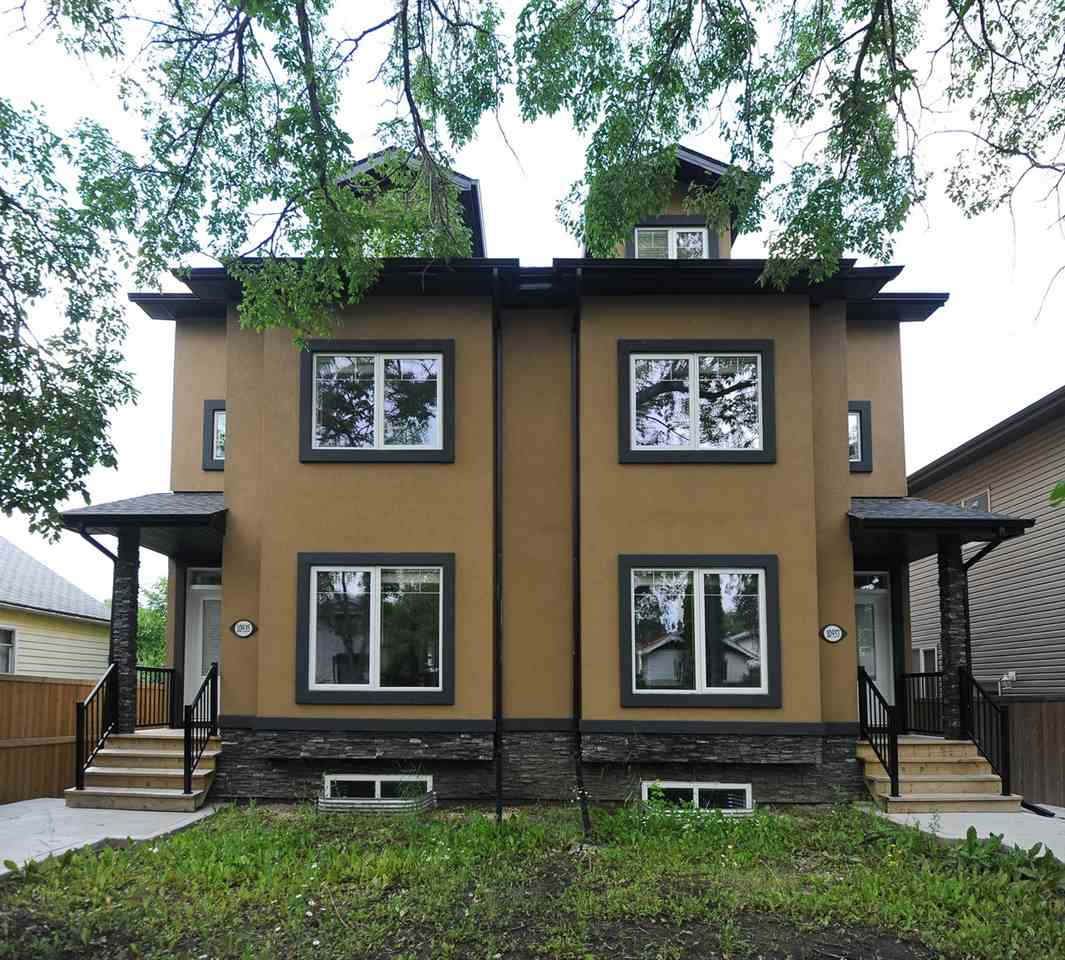 Location! Location! Location! investors make a attention. Fantastic investment property 3 story half duplex in McKenna Community! You will be impressed from the moment you step into this incredible house! Perfect location close to downtown, U of A and Whitey ave! Also, walking distance to all schools. The south facing back yard features excellent natural light on all levels. The chef's kitchen features Samsung stainless steel appliances including a water&Ice double door refrigerator, gas stove, and hood cover. Unbelievable 9' ft ceiling main floor features one bedroom, full bathroom, dinning room, and family room. Second and third floor features 4 bedrooms with ensuite bathroom plus one remarkable masterbedroom. The masterbedroom features walk-in closet & luxurious 5 piece ensuite bathroom. Three more generous sized bedrooms and full 3-piece bathroom both complete the basement of this pristine home. Granite counter tops in all bathrooms. Don't be wait call it home now !!!!