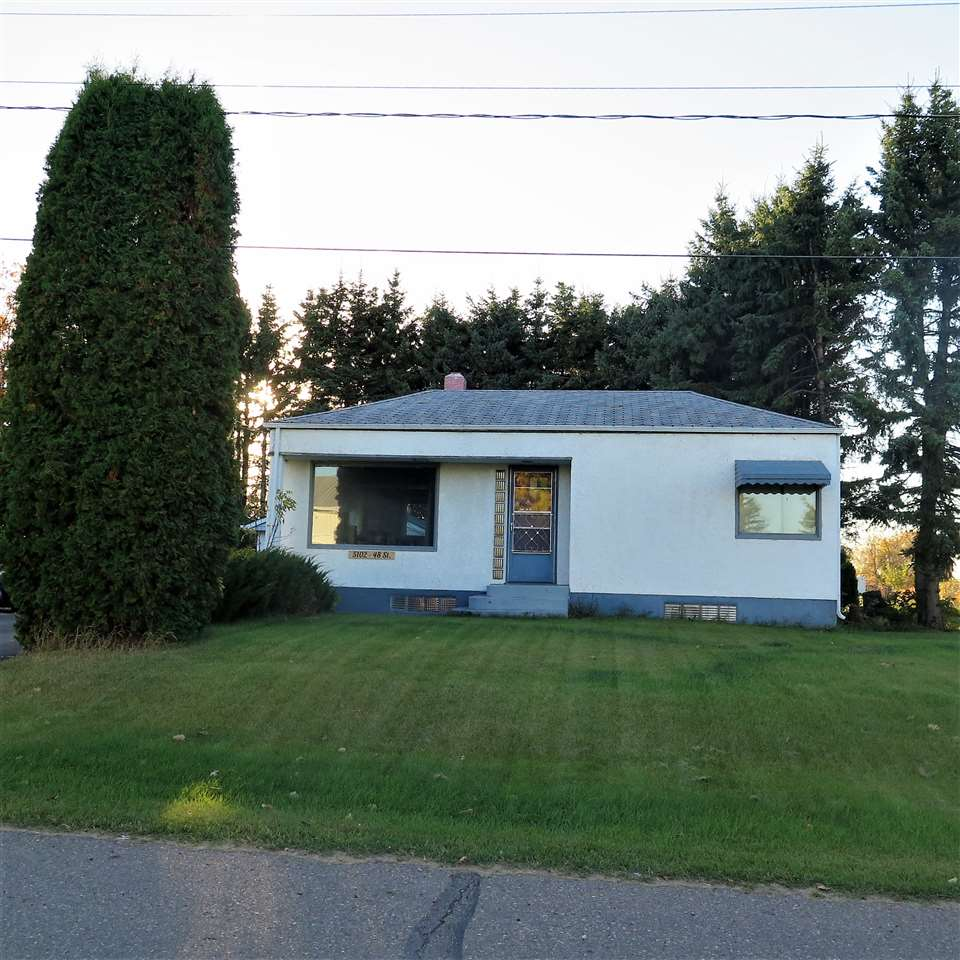 A lot of liveability in this 945 Sq Ft. Bungalow with 2 Bedrooms upstairs & 1 bedroom down.    Upgrades include paint, some windows, vinyl flooring in living room and in the basement.  Plumbing and  Electrical (upgraded to 100 amp) throughout.  New hot water tank.  Basement has 220 amp for portable heater.   Porch accommodates the washer and dryer.  16? x 24? heated  garage,  and a separate parking lot off the driveway  for at least 6 vehicles.    Private, quiet, walk to school.    Priced to sell!!