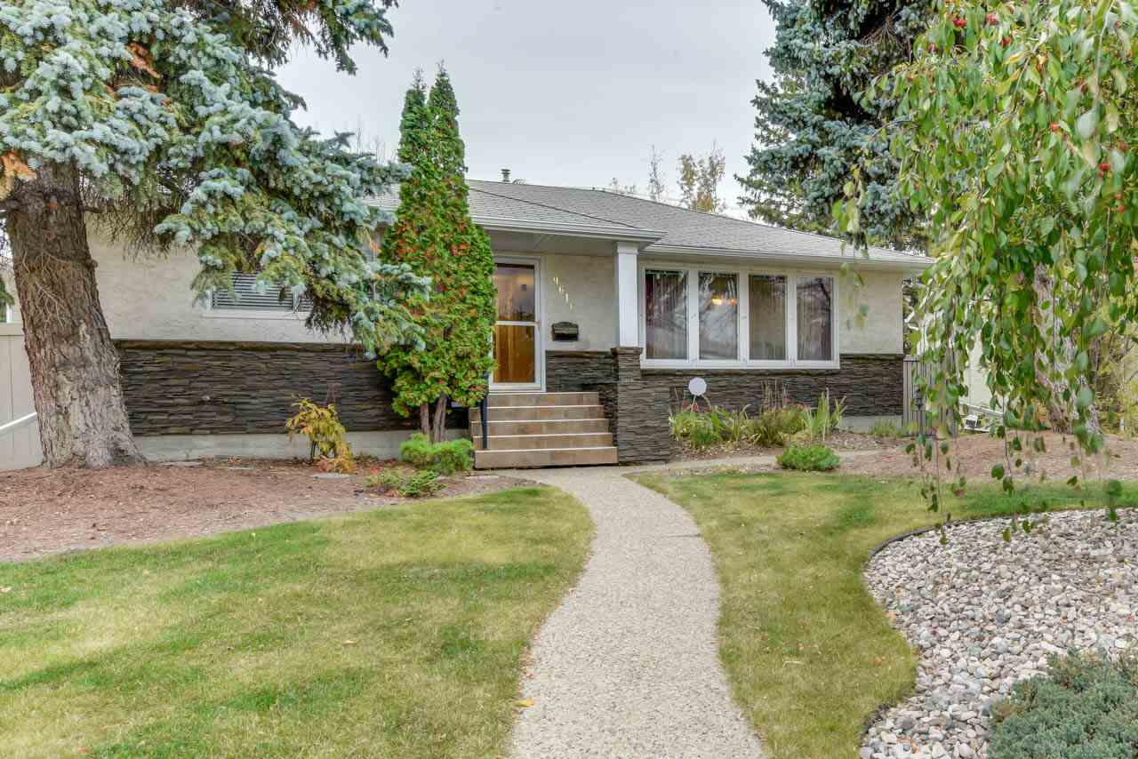 Crestwood Beauty in a Park-Like Setting!! This is a lovely, clean, open and well maintained home in one of Edmonton's finest neighbourhoods. Bungalow 1268 sq ft with gleaming hardwood throughout most of the main, lots of built in shelving. Double French doors open to living room with coved ceiling detail, built in cabinetry and lots of space for big furniture. Kitchen is fabulous with brand new stainless appliances, tons of counter space and cabinets and built in wine fridge, all designed with the cook in mind! Absolutely outstanding basement development with gorgeous rec room, large bedroom, stunning bathroom plus a huge laundry/storage room. Lovely composite deck with aluminum rails off rear bedroom. Oversized 24x24 garage in back with excellent RV parking! Pleasant curb appeal, nice front and rear landscaping with exposed aggregate patio and sidewalks. Close to shopping, central location, great schools. This home is an excellent value in Crestwood!