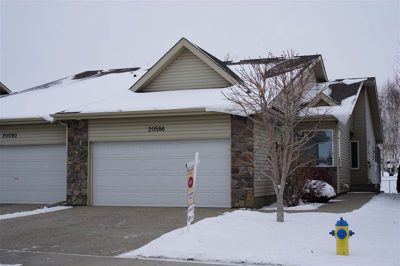 Serenity & Elegance welcomes you to this fully finished adult bungalow,which is perfectly situated on the Lewis Estates Golf Course.The stunning main floor boasts an open concept with new hardwood floors,paint,upgraded iron staircase,vaulted ceilings & panoramic views of the golf course.The designer kitchen has gorgeous cabinets,granite,stainless appliances & centre island.Enjoy hosting family gatherings & holidays in the spacious living & dining room.The bright master bedroom is a treat with it's 4pc ensuite (w/soaker tub).The main floor is complete with a front foyer;den (w/vaulted ceilings);a 2pc bath & laundry/mudroom.The basement boasts a large rec room with cozy gas fireplace;a 3rd bedroom with walk through closet,4pc bath;& huge storage area.Take in the summer views on your gorgeous back deck or enjoy the peaceful winter views from inside.Snow & lawn maintenance isn't a worry or hassle as it's all included in the HOA fee.This duplex is everything that you've been waiting for.Welcome Home!