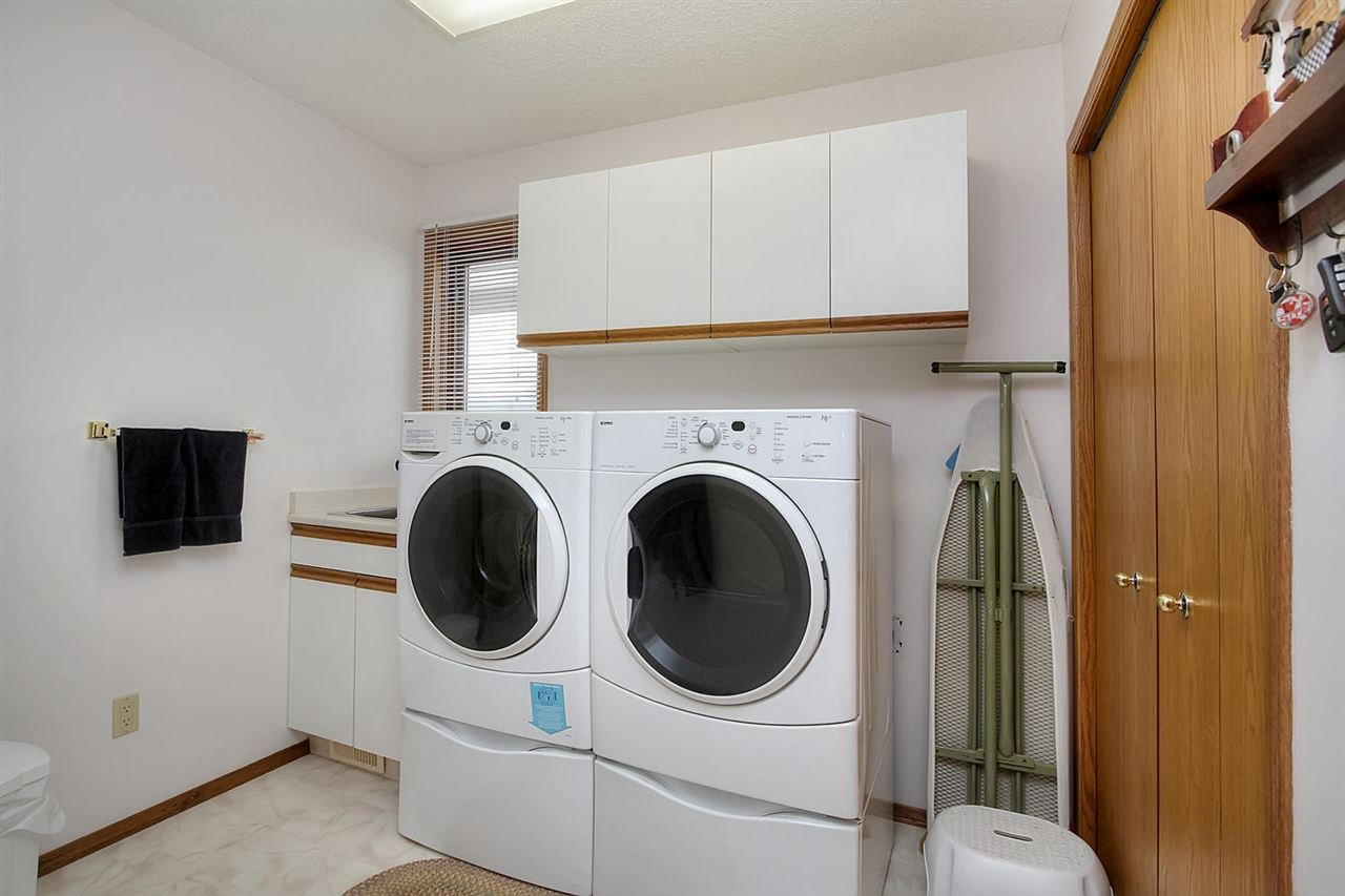 Space to do the job right is available in this awesome laundry room that enters into the garage. A handy soaker sink, plenty of storage and even room to open up the ironing board and go crazy.