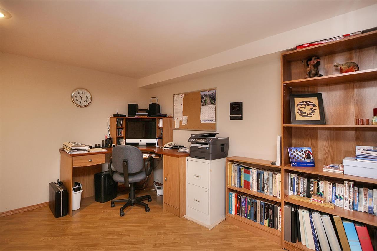 A den downstairs is a great space to organize your paperwork or to work from home.