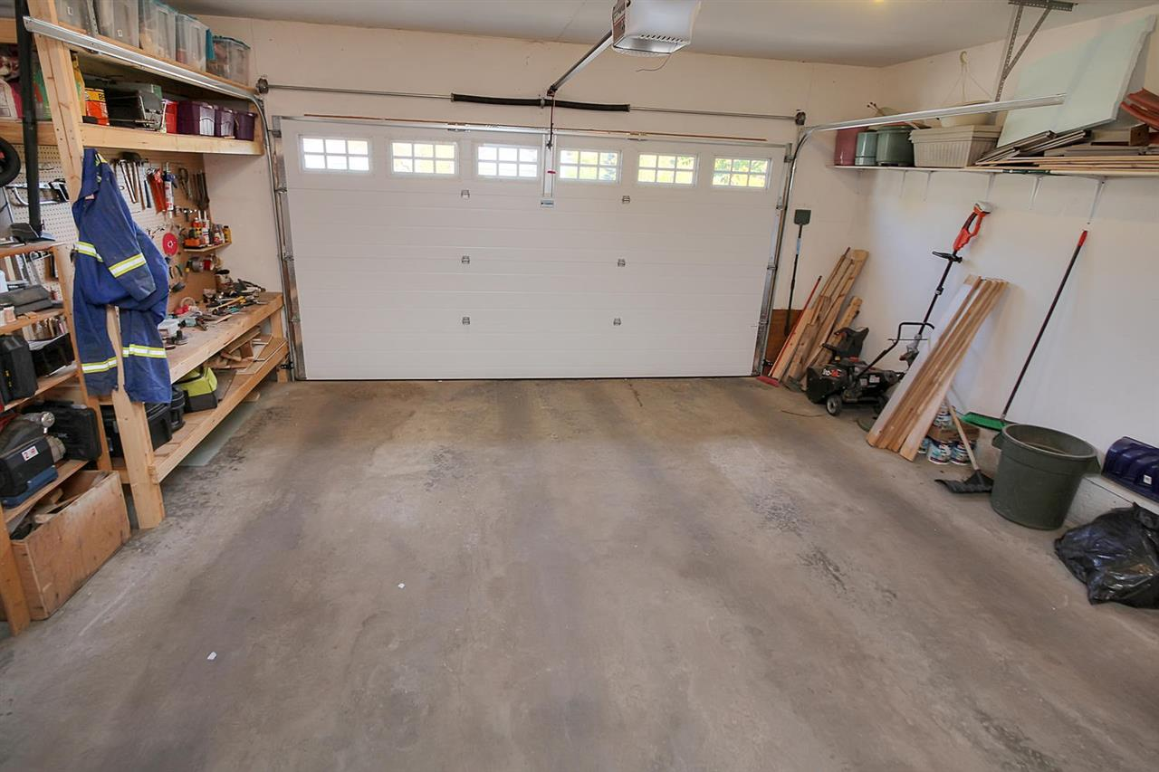 The garage is a square... It is 21 ft 4 inches wide and long. The shelving that is attached will stay so you can also be organized here. It is insulated, dry walled and painted.