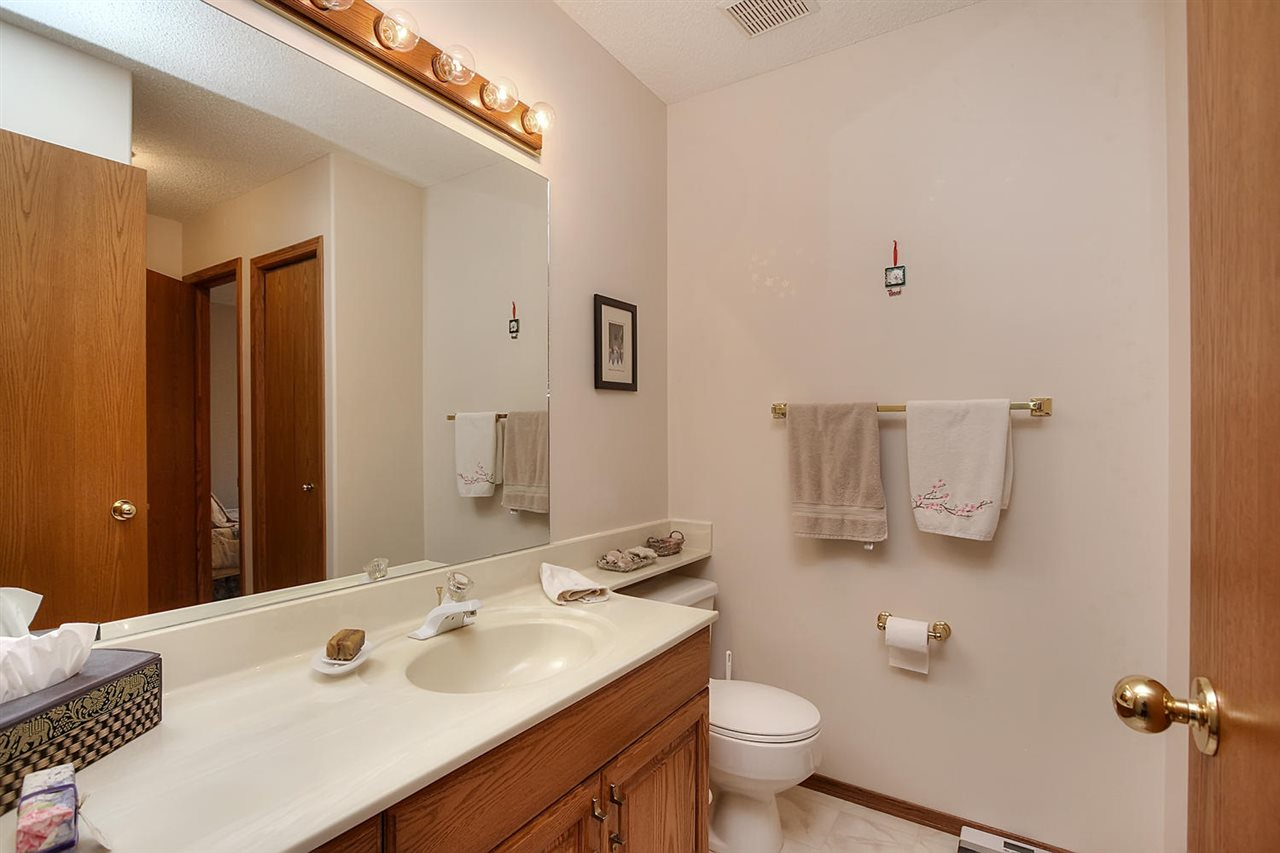 This is the main bathroom on the main floor that has a cheater door leading into bedroom # 2