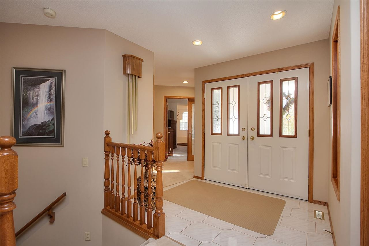 The front entrance is spacious and has another set of double doors. This is a welcoming area for family and friends.