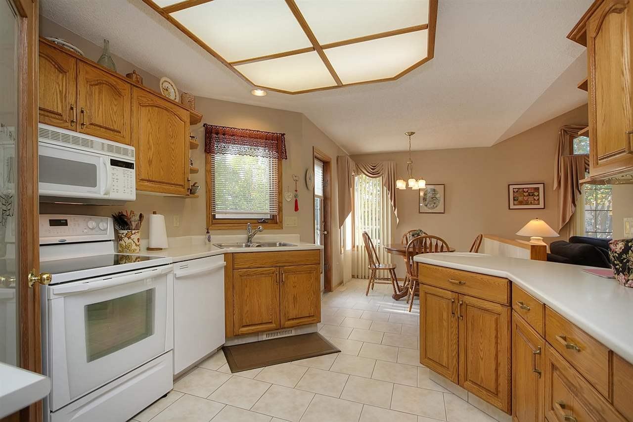 This oak kitchen is very well designed and includes a large corner pantry for even more storage. An eat in area is at the rear of this large room and has a door leading to the deck for handy bar b ques