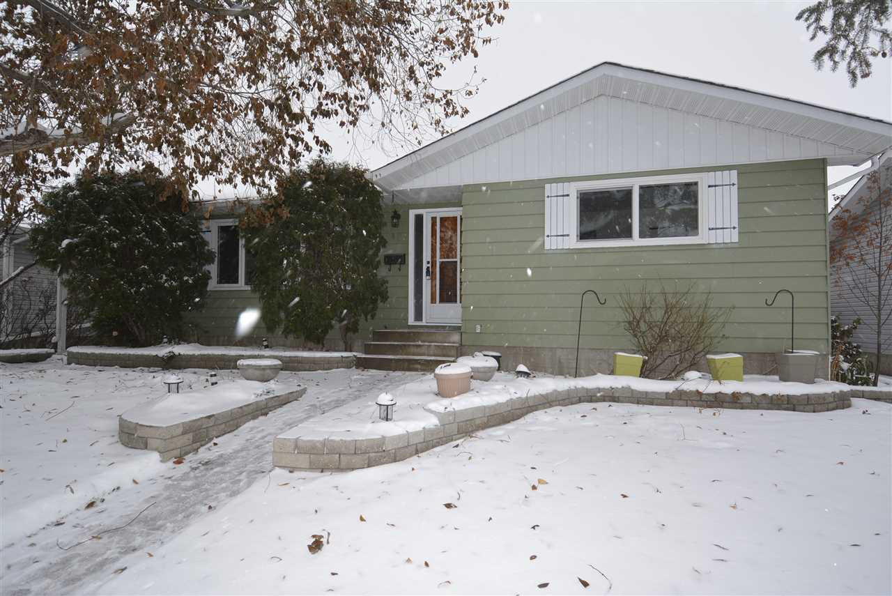 Fantastic location! Close to schools, hospital and shopping! You will love this 1237 sq.ft. fully developed bungalow with lots of upgrades. Enjoy a newer kitchen, hardwood,  windows, shingles and a renovated recreation room with vinyl plank  flooring. This home is carpet free!  OVERSIZED 27' x 24' finished and heated GARAGE! Garden doors from the kitchen open up to a massive deck that is pre-wired for a hot tub. Stone inlaid sidewalks enhance the fully landscaped & fenced back yard.  Handsome metal spindled railing leads to the back entry and stairway to basement.  Fully developed basement, with 4th bedroom, offers lots or space for entertaining and family enjoyment!  Move in and enjoy! Great home-great location!