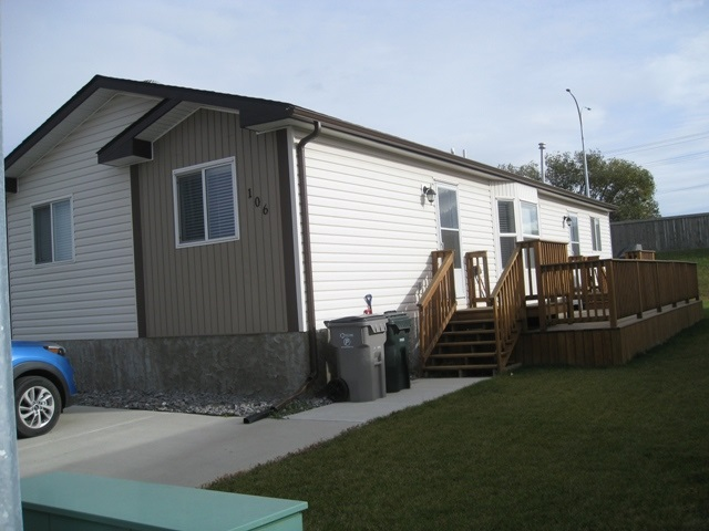 This very well maintained 3 bedroom home is looking for a new owner. This kitchen has lots of maple cabinets and lots of counter space too. The pantry has lots of storage for food and small appliances. Has a large living room with cathedral ceilings. The master bedroom has a 4 piece en-suite with a soaker tub along with a large walk-in closet. The other 2 bedrooms are a real good size too. Outside you have a large tiered deck and concrete pad for 2 vehicles. Why pay rent when you can own your own home and lot for only $249,800.00