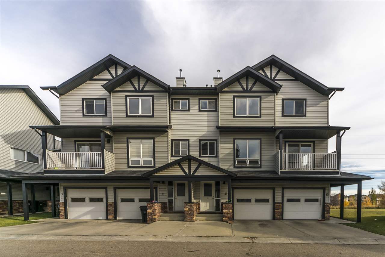 Great value in this 1420 sq ft. (developers size) 3 storey townhouse located in the fabulous community of Summerwood. Enter on the ground level through the welcoming front door or through your single attached garage. Proceed up to the second level to find your large open concept great room, powder room, kitchen, & dining room with sliding doors leading to a patio to enjoy your morning coffee. New durable modern vinyl plank floors spans throughout this level. There are a abundance of windows to let in the natural light. On the 3rd level you will find 3 large bedrooms, 2 full baths and the convenience of a laundry room. Two of the bedrooms have walk in closets and the master has a full ensuite feat. a 4 piece bath! This top level also has a large balcony to relax on. Property is located along a peaceful and relaxing pond. Location, location, location being just off of Cloverbar Road makes for quick access to Baseline Road, the Yellowhead & the Anthony Henday. Wonderful starter home or investment property.