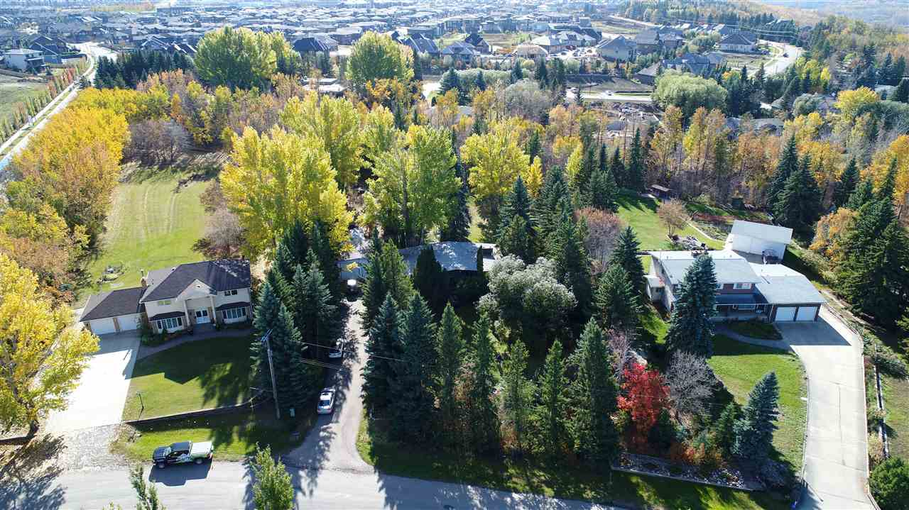 Welcome to Windermere Crescent premiere acreage living in the city! This spectacular lot is one of the few that backs onto the ravine. It features many mature trees and nature you won't find anywhere in the city! Also being a close drive to windermere common, schools, parks, the Anthony Henday, and the International Airport are just some of the other features this property has to offer! With over an acre of land this is the perfect lot to build your dream home on with stunning ravine views! This lovely 1800 sqft. bungalow situated within this beautiful yard features 3 bathrooms and 5 bedrooms, a 3 way stone fire place on the main floor, as well as an office and finished basement. Call this premiere neighbourhood of Windermere home today!