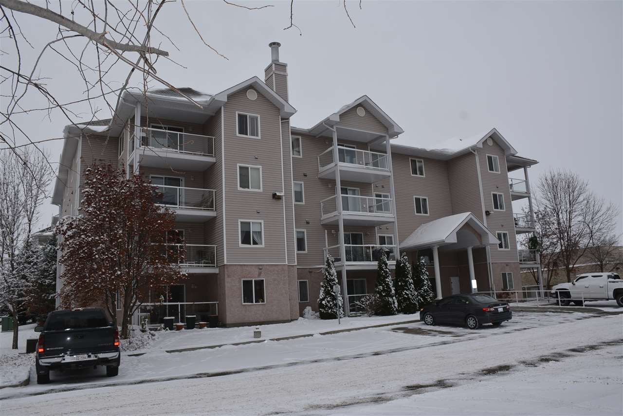 Ready for a different life style? No more hard work? Quick possession? This two bedroom condo unit offers stress free living at its finest!  Enjoy the gleaming white kitchen with island, adjoining eating space plus the spacious living room with corner fireplace and patio doors leading to a maintenance free deck with glass panels. The master bedroom features a walk through closet into a three piece ensuite which boasts a walk in, dual sit down shower. In suite laundry makes this chore a breeze! Main 4 piece bath completes this unit. Heated underground parking and A/C in the hallways and lobby. Condo fees include heat, water and Shaw cable. Close to downtown amenities, restaurants and public transportation. This is a 40+ adult living  complex.