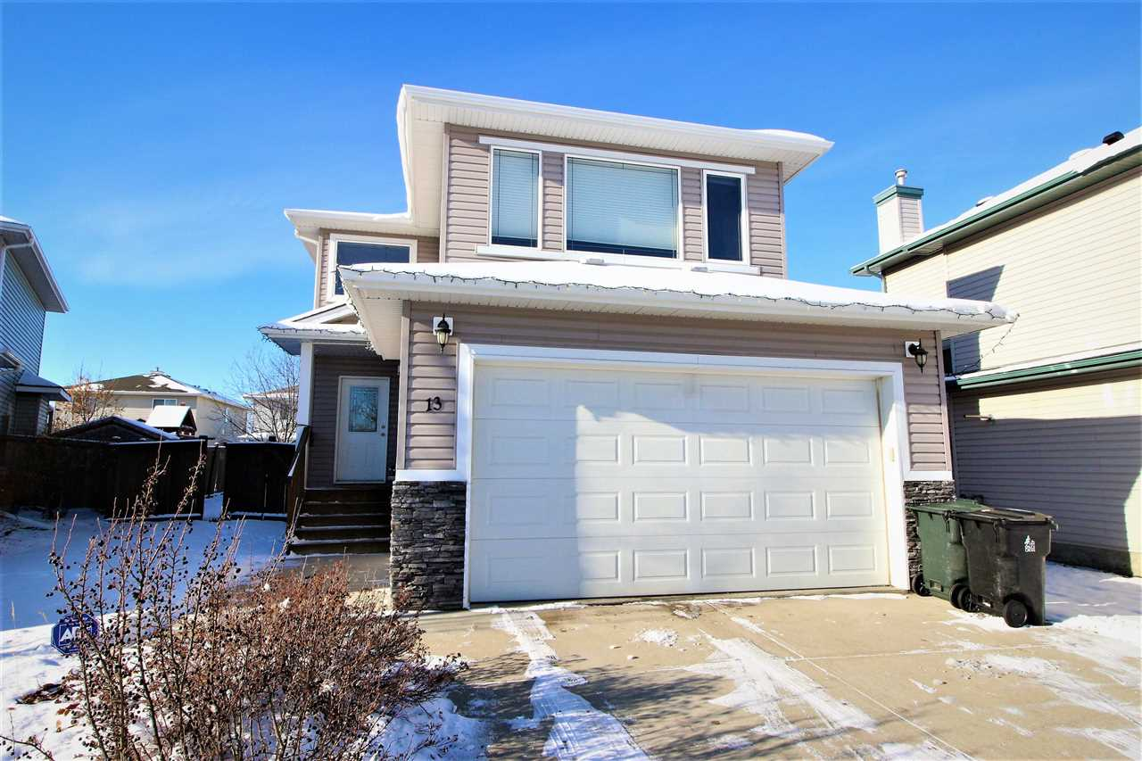 CUL-DE- SAC location! VALUE packed! TLC just minutes away! These are just some of the features you?ll enjoy by owning 13 Lamplight Cove! Welcome to this 1700 sq ft two-storey home! Soaring open to below ceilings will greet you upon entering this functional and spacious home. The main floor features an open concept kitchen to living space with a cozy corner gas fireplace, two piece bathroom, and back entry laundry! Upstairs has a huge bonus room with tons of natural light, three bedrooms, and a master retreat that you can relax in! Outside is a huge fully fenced yard where you can enjoy the west sun on your full length deck that is set for entertaining. Stay cool in the summer months with central AC! Updated vinyl plank flooring in the home is durable and attractive. This home is DEMANDING action, so come investigate today!