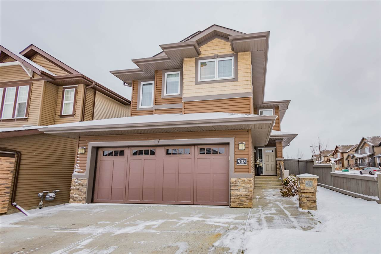 Absolutely stunning 2-storey home in the quiet community of Hawks Ridge. This home welcomes you w/ its gleaming hardwood floors and spacious foyer. Entertaining is easy in this home, as the kitchen includes, granite, an induction stove, dble oven, corner pantry, and plenty of cabinets. The living area showcases a beautiful gas fireplace. Dining area leads you to your low-maintenance fully fenced yard. Imagine sitting around the outdoor fire and relaxing on this thoughtfully built patio, finished w/ stamped concrete. Upstairs you will find a bonus room, 3 beds including master, and 4pce bath. Master is a dream come true w/ a huge WIC, and 5pce ensuite w/ a jetted tub and his/her sinks. The other 2 beds on this floor are of generous size. Main floor includes laundry 2pce bath, and private mud room. Basement is left unfinished ready for your personal touch. Located mins from the Henday & Yellowhead, makes getting around is easy. Close to Lois Hole Provincial Park which is a breathtaking natural setting.