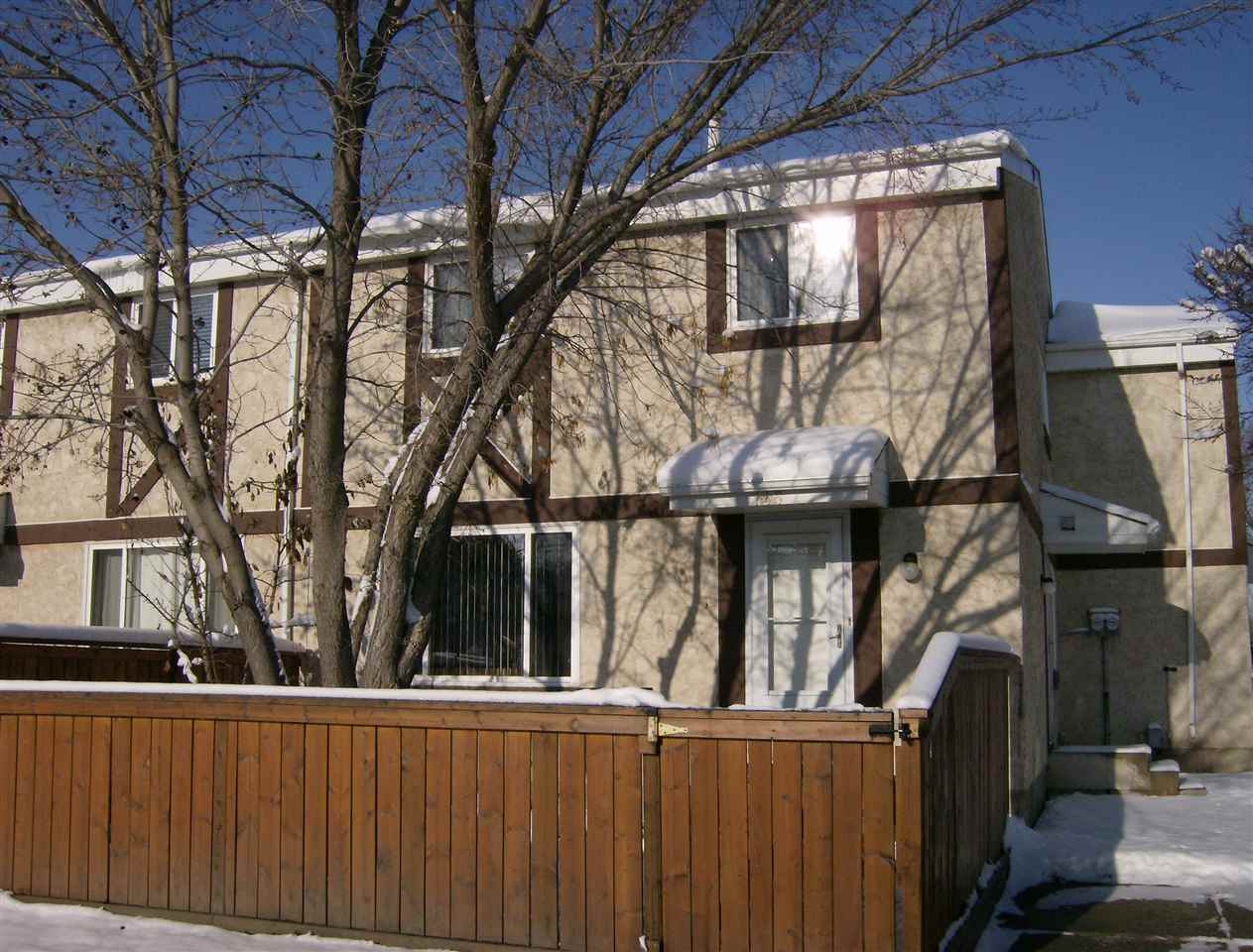Bright and airy 2 storey, 3 bedroom townhouse close to West Edmonton Mall! High lights of this well maintained home include a fabulous remodeled kitchen, no carpet so allergy friendly, two entrance doors, and a close parking stall with plug in. Large living room with picture window, tons of cupboards in the kitchen with newer counter tops, it's own kitchen window, separate dinette, and a 2 pce bath .Fridge, Stove, Dishwasher and the Dryer were new in 2016.  Upstairs you will find a generous master bedroom, 2 kids bedrooms and the main bath with newer tub and vanity. Basement ready for your ideas. No pet, no smoking home. Low condo fees of $295.00 per month in this well run complex.