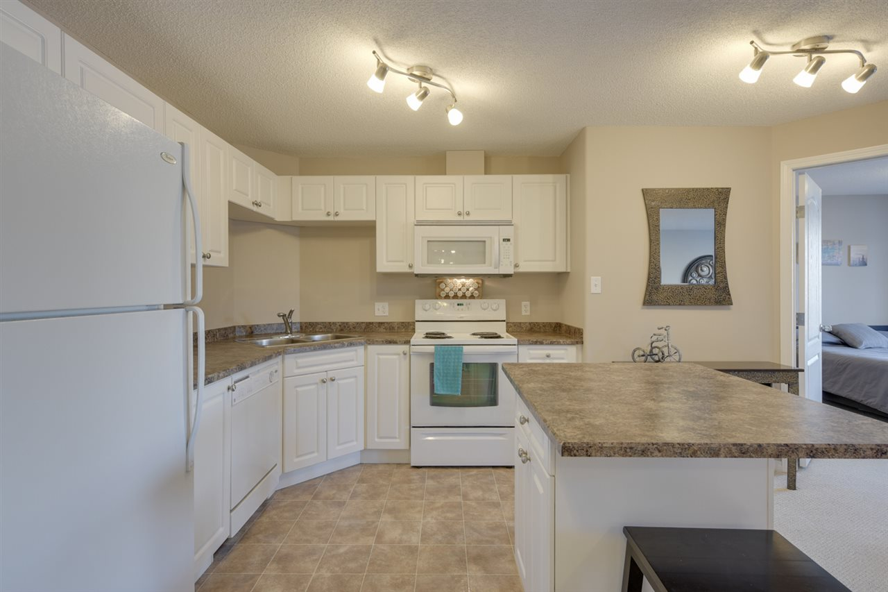 Fantastic second floor 2 Bedroom 2 Bathroom condo with 2 parking stalls. This is a great investment and place to call home. Your beautiful unit is facing east so you get great sunshine to enjoy your morning coffee on the large balcony.  You have a large master with a walk through closet and full ensuite bathroom. The second bedroom is on the opposite side of the condo so is great for privacy. There is a second full bathroom as well as a storage/laundry room. This unit has been freshly painted and is move in ready. Nothing to do but enjoy your new home. Great layout with open concept living room open to your kitchen and dining area. Low Condo fee ($288) includes all utilities except electricity. The location is ideal as you have easy access to the Anthony Henday and you have all of your amenities nearby. Terwillegar is a great neighborhood and this is a great buy. Come see today!