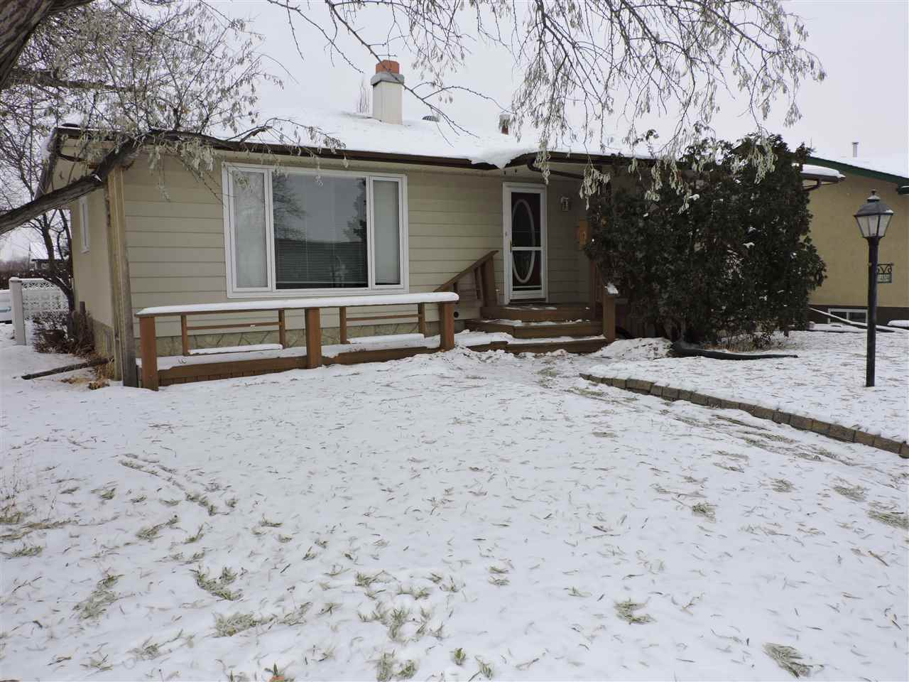 Calling all investors. Judicial sale. PRIME LOCATION!! Corner lot in well established area! This nearly 1200 sq.ft bungalow with a back split entrance has 4 bedrooms, 2.5 baths which includes master bedroom unsuite. This home has a large living room w/ fireplace as well as ample kitchen space. Basement is equipped with wet bar, laundry, bed, bath and fireplace in living room as well. Comes with detached double garage, fenced yard and beautiful front yard deck with McLeod community league and school across the street.