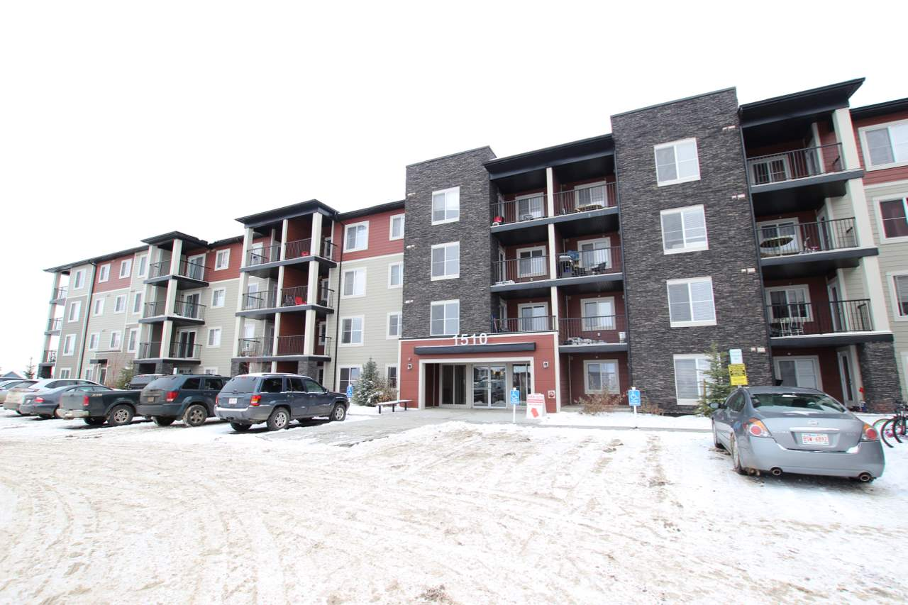 """LIKE NEW 2 BED 2 BATH CONDO! This unit sets itself apart from the others with IN-SUITE LAUNDRY and TITLE UNDERGROUND HEATED PARKING WITH PRIVATE SECURE STORAGE! This 2nd floor unit is perfect for the first time buyer, down-sizer, family or investor! """"METRO"""" is one of the most popular layouts! As you walk through the door you will appreciate the open concept and modern design. The luxury kitchen features stainless steel appliances and granite countertops! As you continue through the unit feel the warmth and beauty of natural light coming from this SOUTH FACING unit! The master bedroom is a generous size and comes with a 4pc ensuite bathroom! Large balcony is perfect to enjoy a summer BBQ and has a rough in for an AC unit. Owner has kept unit meticulously clean. Close access to Anthony Henday, 50st, and Ellerslie Road. Shopping centre nearby all the amenities needed and there is a playground just up the street! Always have piece of mind as this building still has NEW HOME WARRANTY REMAINING! LOW CONDO FEES!"""