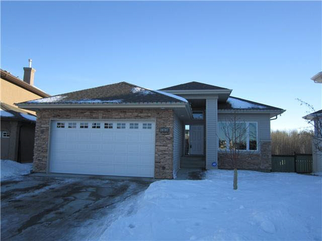 Gorgeous Walkout Basement Bungalow built by Canyon Springs Custom Builder Located in Suder Greens of Lewis Estates. With just over 1500sqft of living space on the main floor plus a fully developed walkout basement, this home offers a spacious open design concept with vaulted ceilings & large windows to allow plenty of natural light. A total of 4 bedrooms & 3 bathrooms. There are 2 bedrooms on the main floor. The generous master bedroom has an open 5 piece ensuite including a jetted tub & a walk in closet. The kitchen boasts a large island with granite counter tops, a walk through pantry & stainless steel appliances. Just off the dining room are patio doors which lead to a large deck & over looks the huge east facing back yard. The basement is complete with 2 large bedrooms, a living room plus a separate flex space perfect for home gym or games room. The walkout basement has plenty of windows & a rear entrance which leads to the back yard & covered patio. Walk distance to Golf, ETS, shopping & schools.
