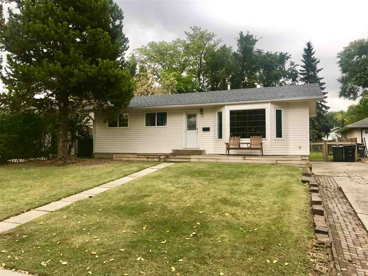 Updated quaint bungalow located in the heart of Sherwood Park, within walking distance of elementary school, shopping and public transport. Recently upgraded including shingles (2017),hot water tank, furnace, flooring, main floor windows, siding, deck, etc. Step into the foyer and view the large bright from living room with bay window and then carry onto the dining area with the adjoining kitchen that has updated cabinetry and ceramic flooring.Down the hallway you will find the spacious master bedroom and 2 other good size bedrooms and the full updated bathroom.The basement is fully finished and features a HUGE rec room area, 2 more potential bedrooms, 3 pc bathroom with corner shower, utility laundry area and storage room. Massive southern exposure yard that is landscaped, has a huge deck, very big play structure, 2 sheds, and tons of room to build your dream garage!